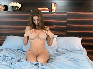 cutie Emily Addison enjoys pinning her stiff nipples