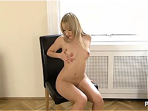 uber-sexy blondie caressing her pleasure button