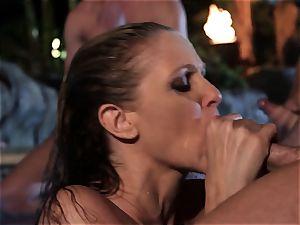 Julia Ann deep-throats a group of lollipops in a pool