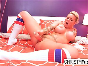 Christy uses a fucktoy on her tight muff