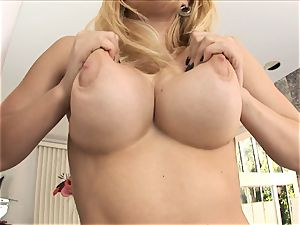 ash-blonde stunner Kagney Karter plays with her phat funbags