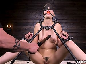 trussed in doggy instrument babe gets lashed