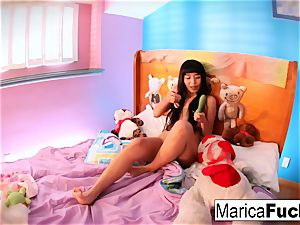 Marica plays with candy knob