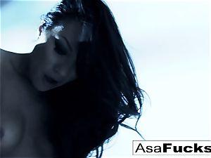 astounding Asa Akira plays with her vulva